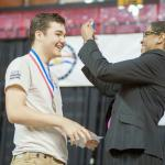 Matthew Broussard receiving National History Day award in 2014.