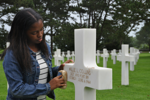 Students visit the graves of Silent Heroes at the Normandy American Cemetery.